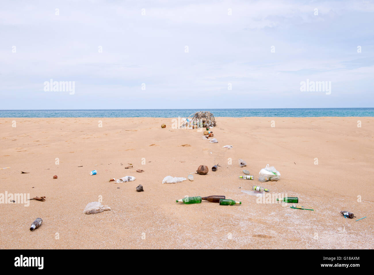 bottles and garbage waste on the beach - Stock Image