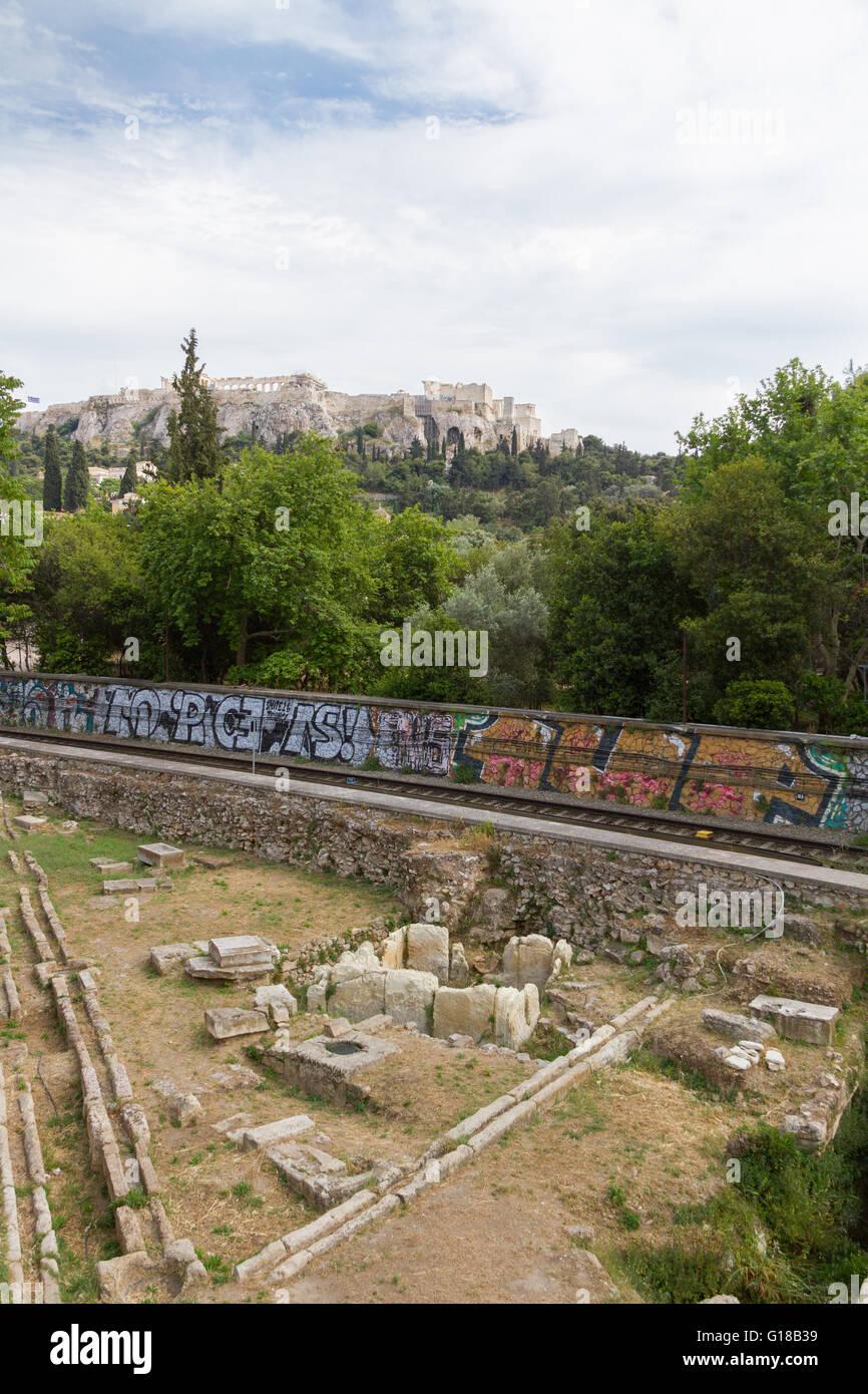 Metro train-line through Athens Ancient Agora with Acropolis in the background. Photo taken in spring 2016 - Stock Image