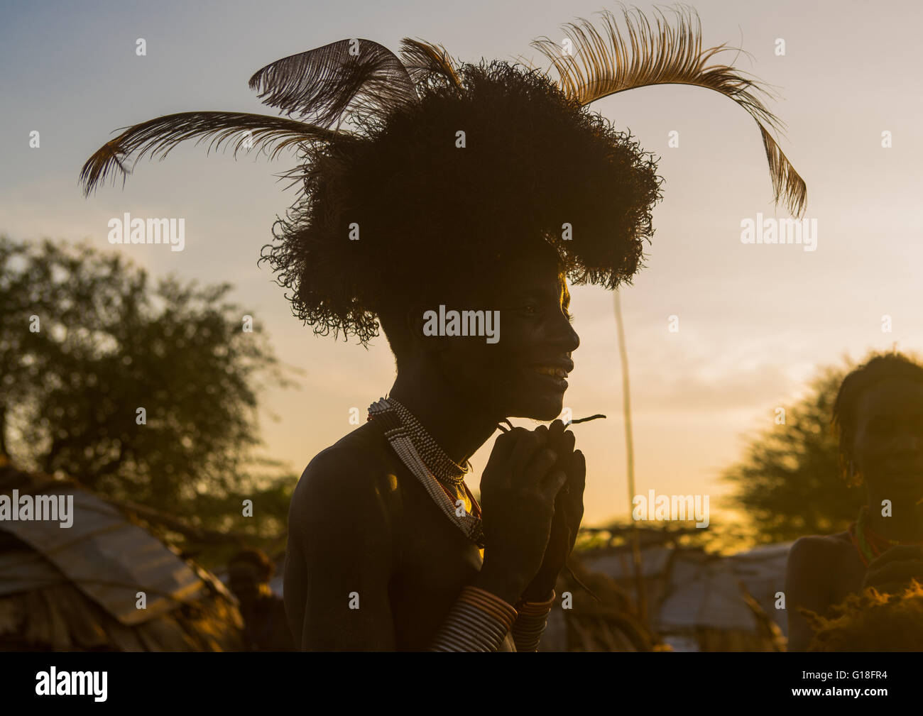 Dassanech man dressing with a ostrich feathers headwear for dimi ceremony to celebrate circumcision of the teenagers, - Stock Image
