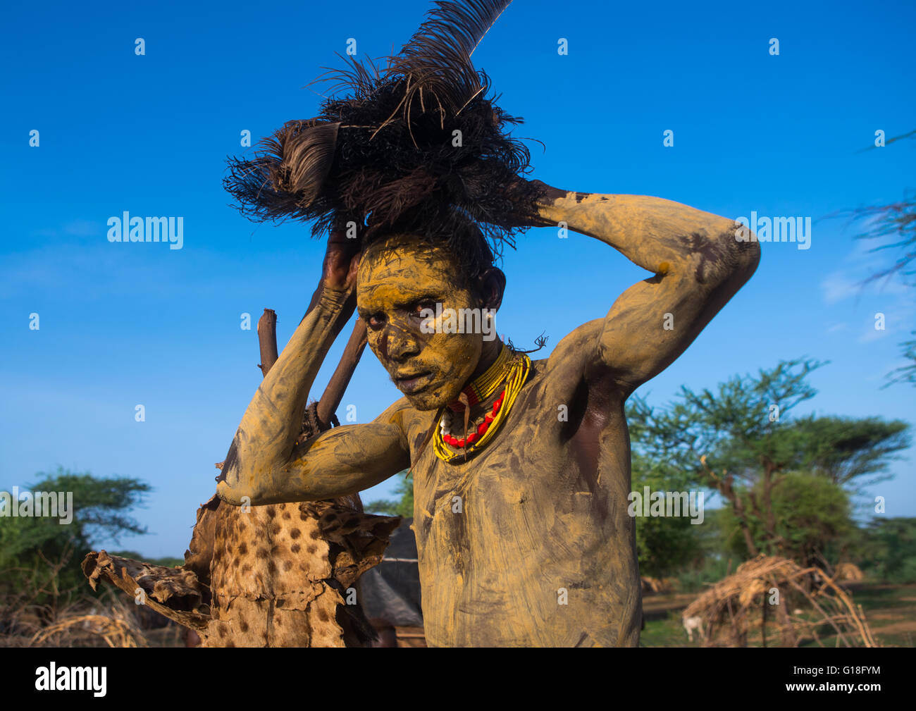 Dassanech man dressing with an ostrich feathers headwear for dimi ceremony to celebrate circumcision of the teenagers, - Stock Image