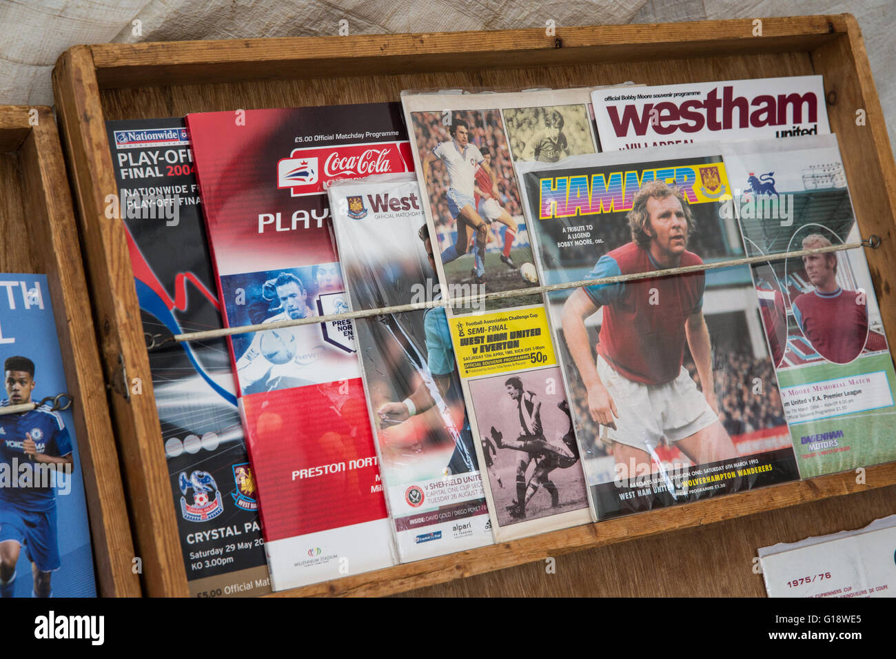 London, UK. 10th May, 2016. Collectors' West Ham programmes on sale in Green Street before the last ever match - Stock Image