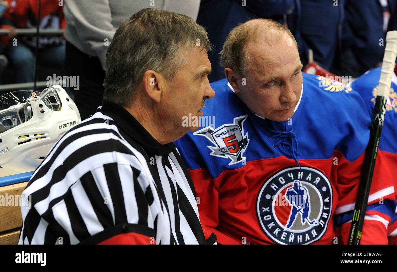 Russian President Vladimir Putin speaks with IIHF President Rene Fasel during a break in play with the Night Hockey Stock Photo