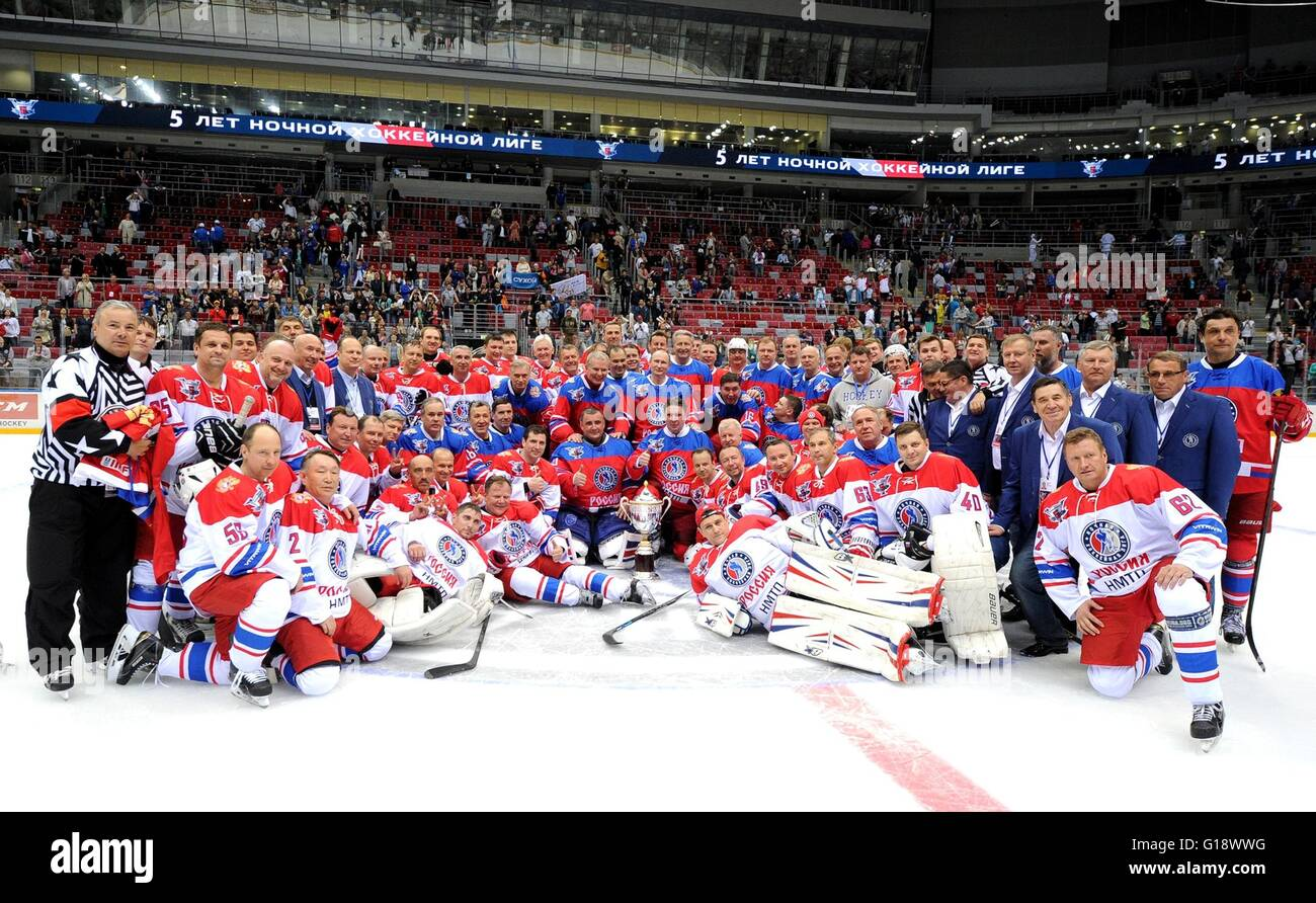 Russian President Vladimir Putin, center, poses for a group photo with players following the Night Hockey League - Stock Image