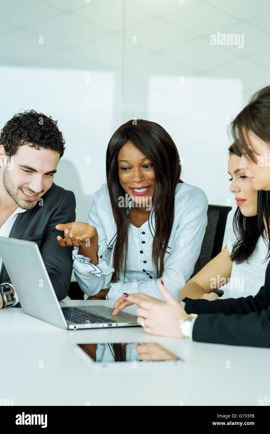Exchange of thoughts during a business brainstorming by happy people - Stock Image
