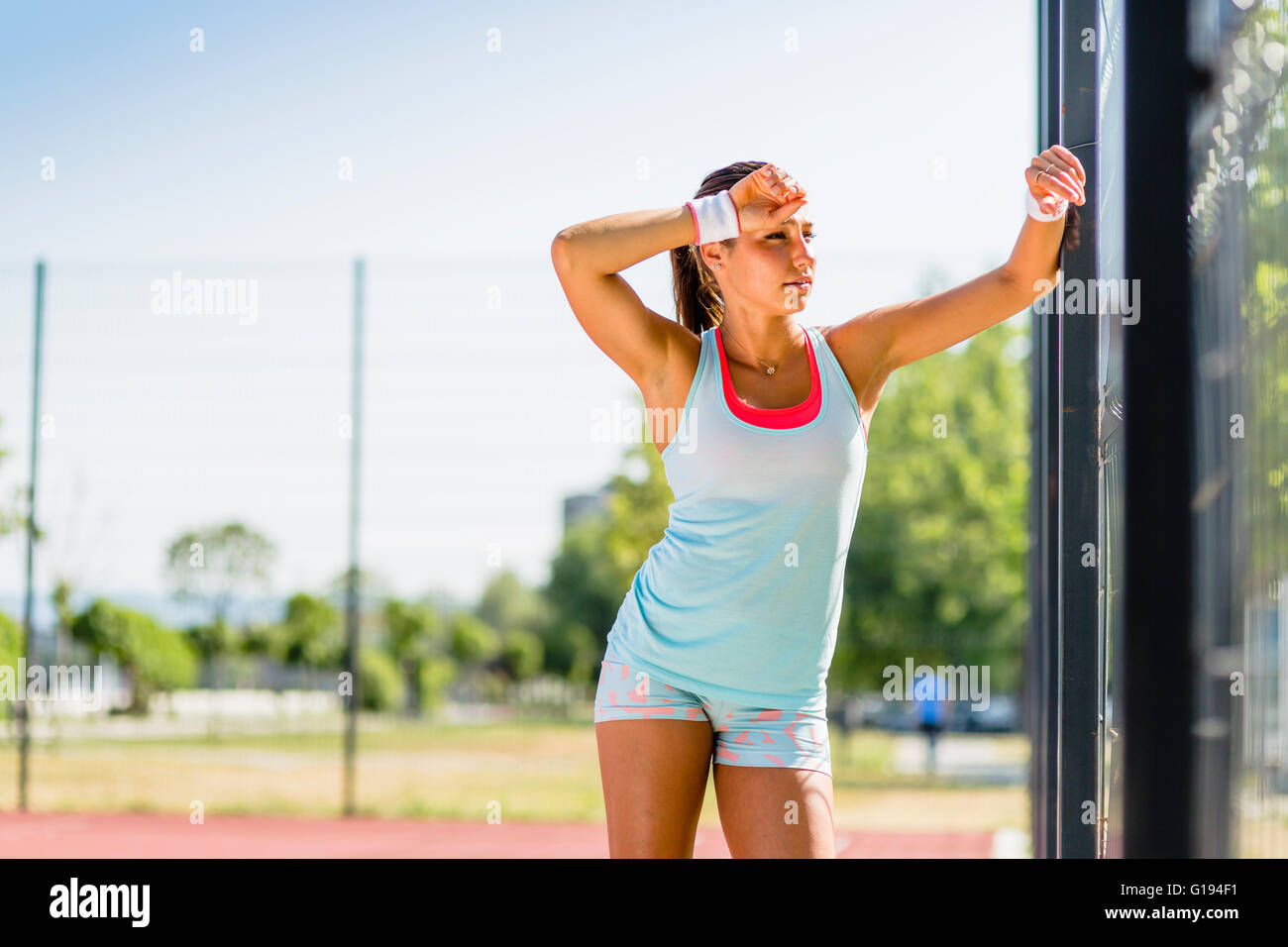 Beautiful young woman taking a break from training - Stock Image