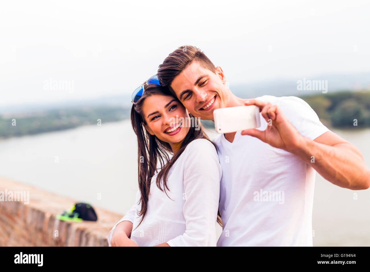 Young beautiful couple taking a selfie of themselves and being happy Stock Photo