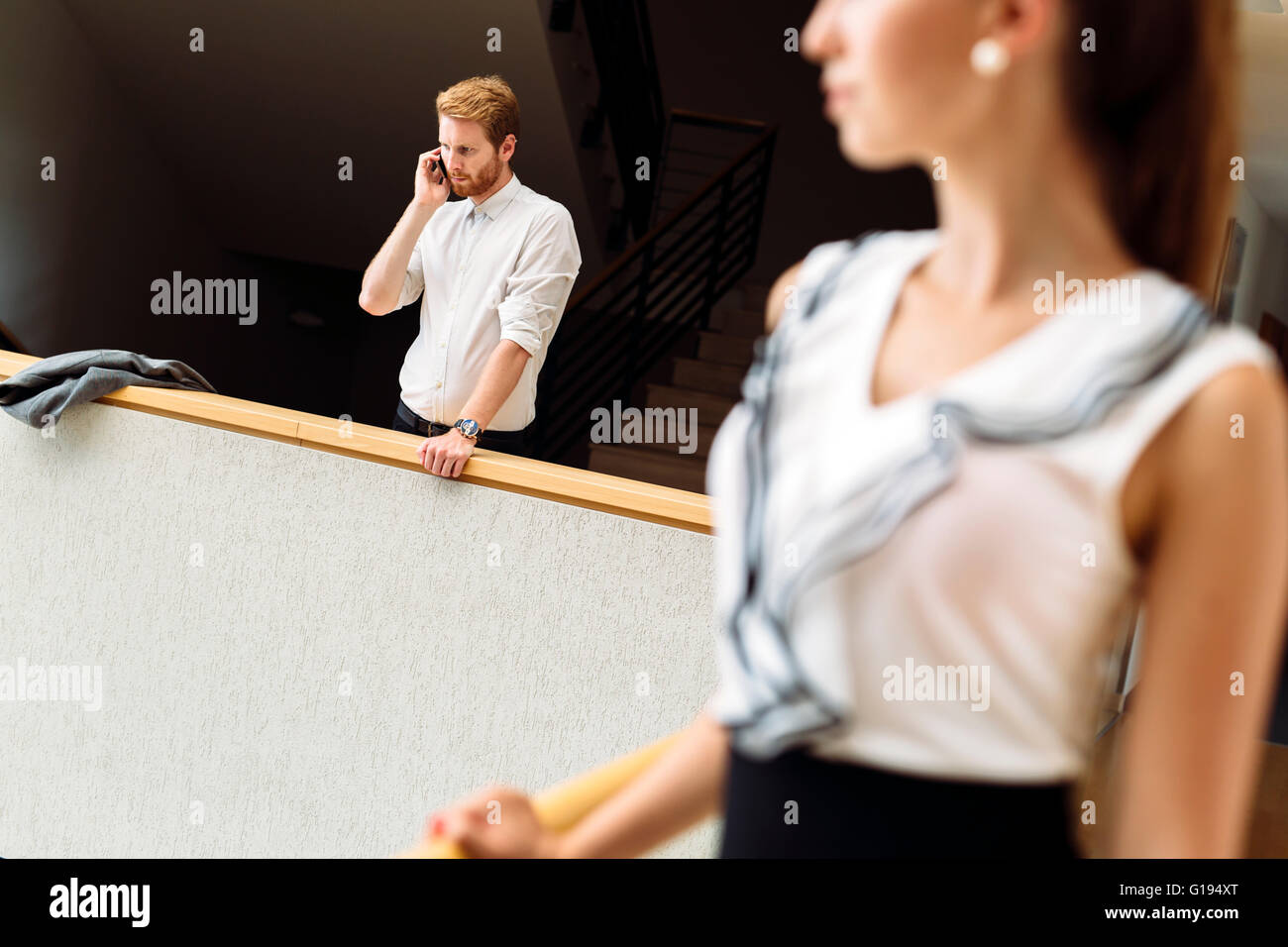 Businessman using phone while having a break - Stock Image