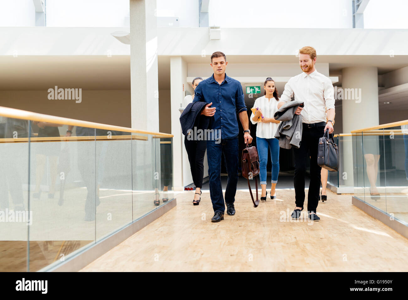Business in motion, walking business people - Stock Image