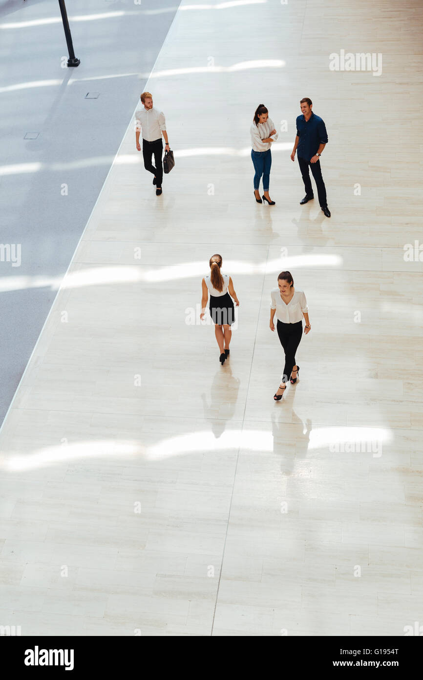 Young business people before starting work in their office - Stock Image
