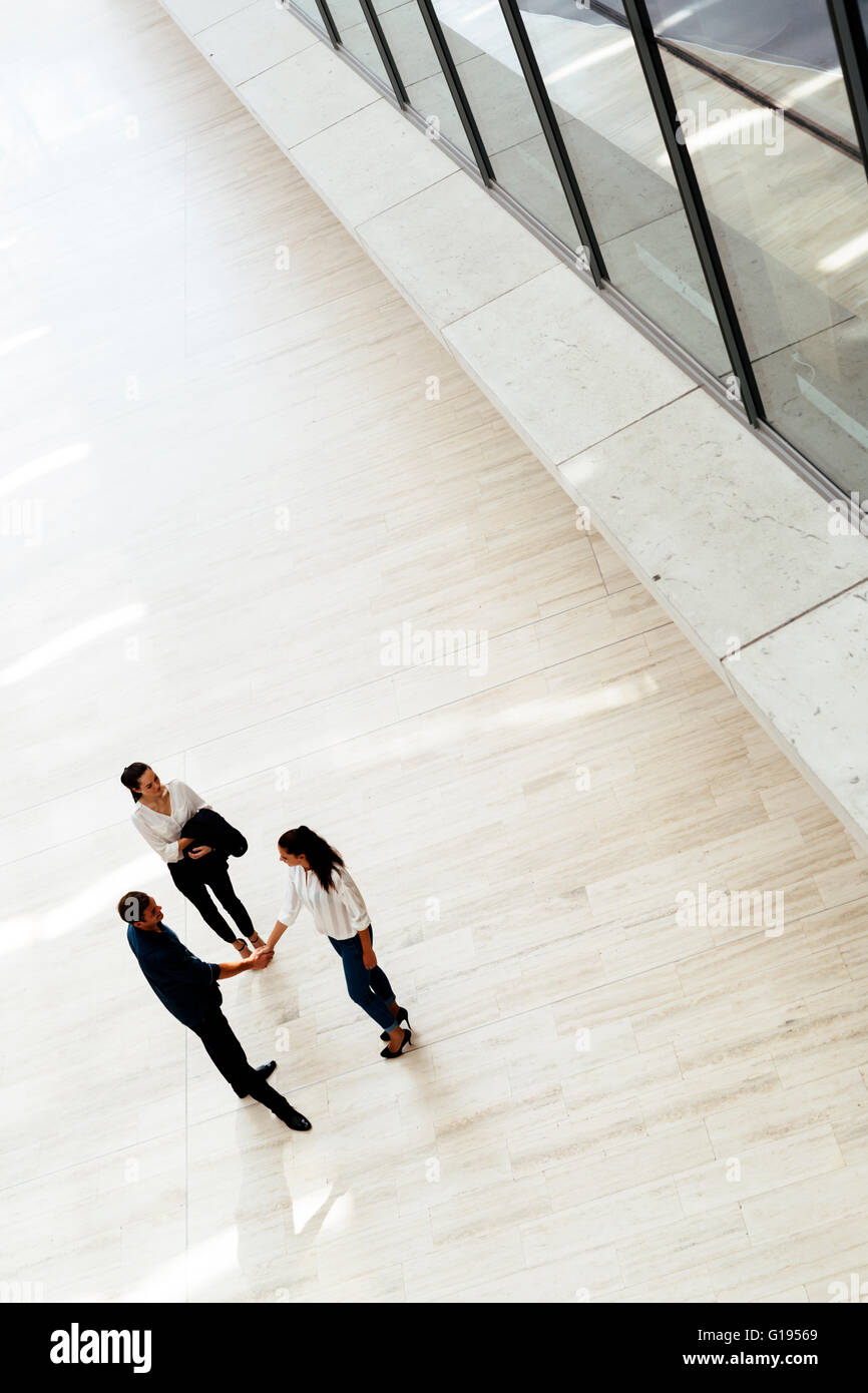 Business people greet each other and shake hands - Stock Image