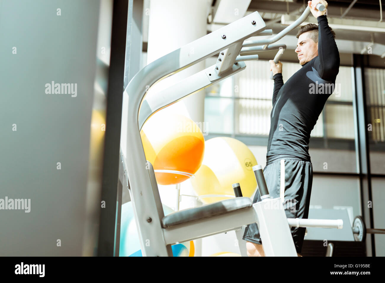 Young handsome man working out in a  gym and living a healthy lifestyle - Stock Image