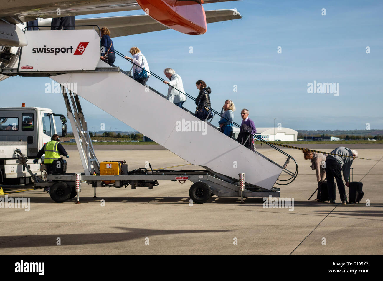 Bristol Airport, Somerset, UK. Passengers boarding an Easyjet aircraft - Stock Image
