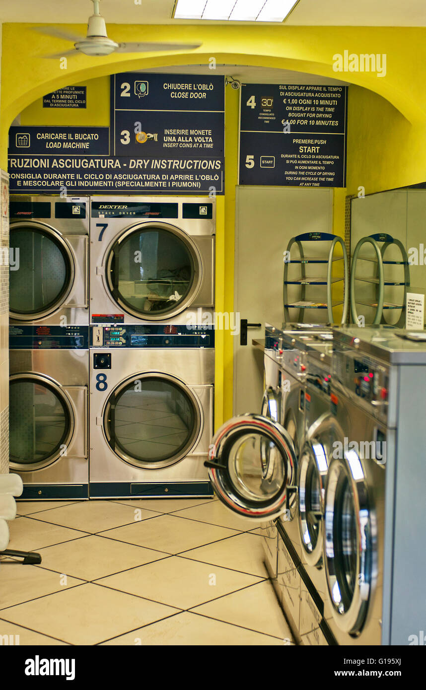 laundrette coin operated washing machines Florence Italy - Stock Image