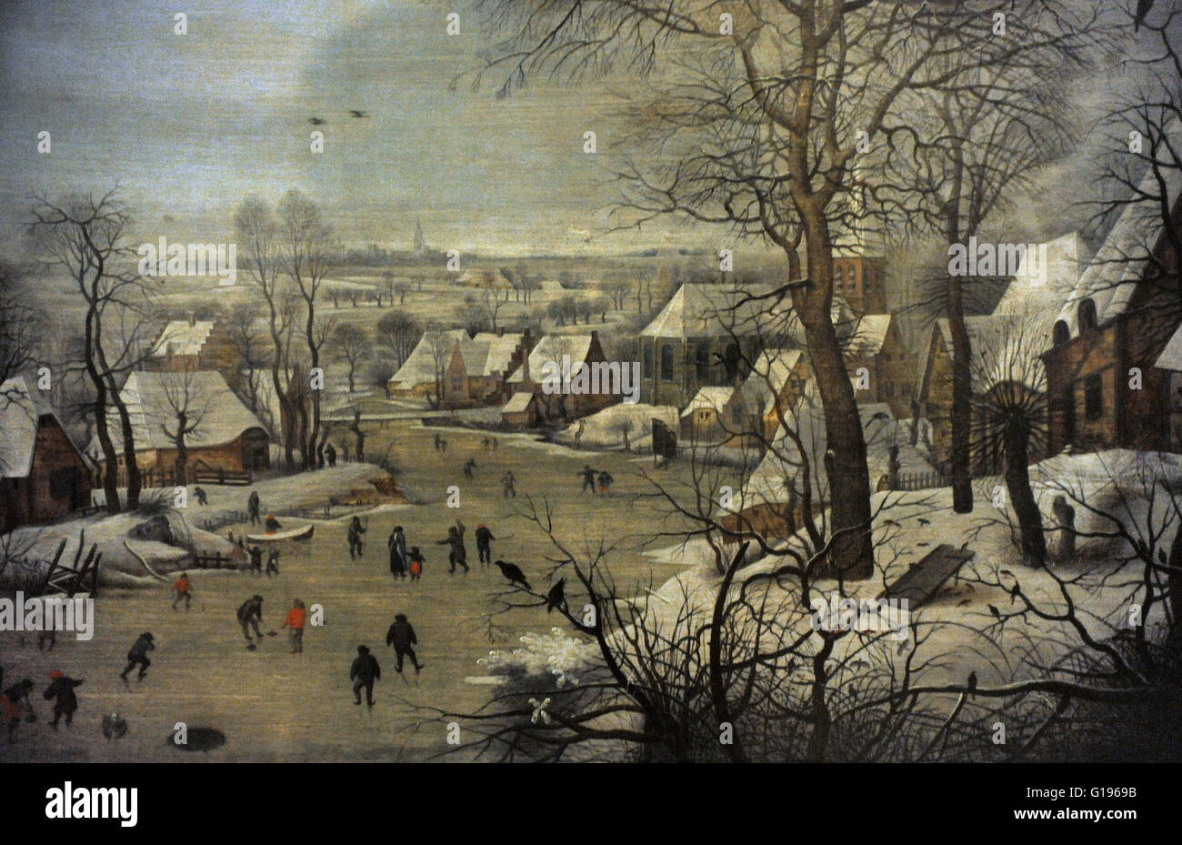 Pieter Brueghel the Younger (1564-1638). Flemish painter. Winter Landscape with ice skaters and a bird trap, 1565. - Stock Image