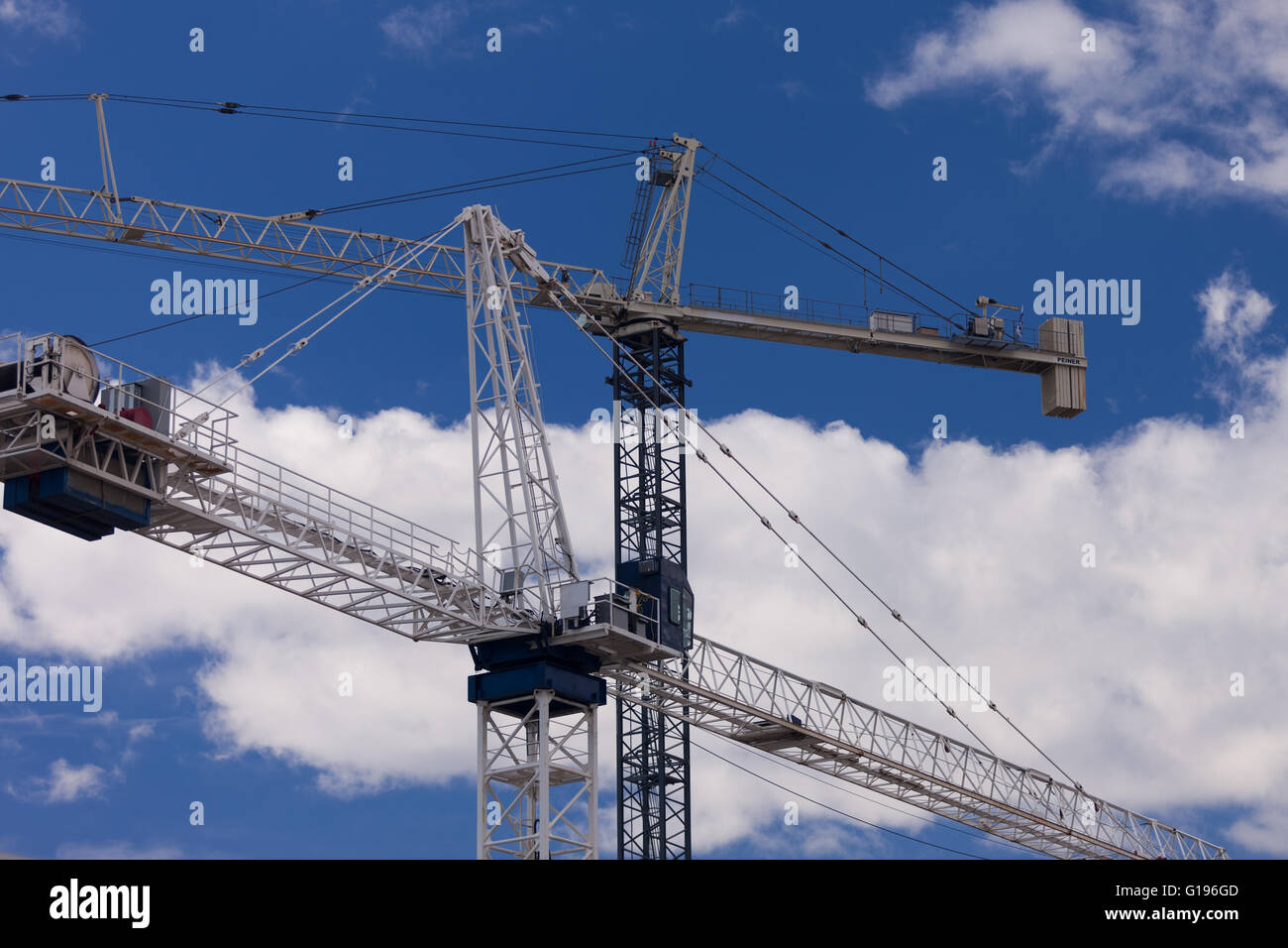 Two cranes work on a constuction site in Burlington Ont, on May 9, 2016. Stock Photo