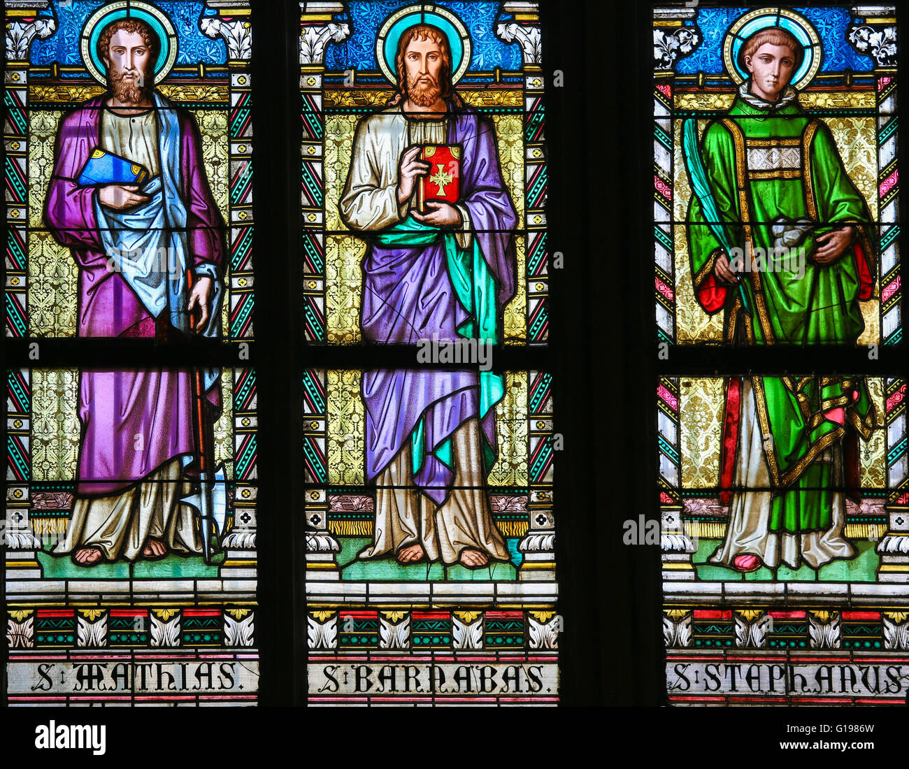 Stained Glass window in St. Vitus Cathedral, Prague, depicting Saint Mathias, Saint Barnabas and Saint Stephen - Stock Image