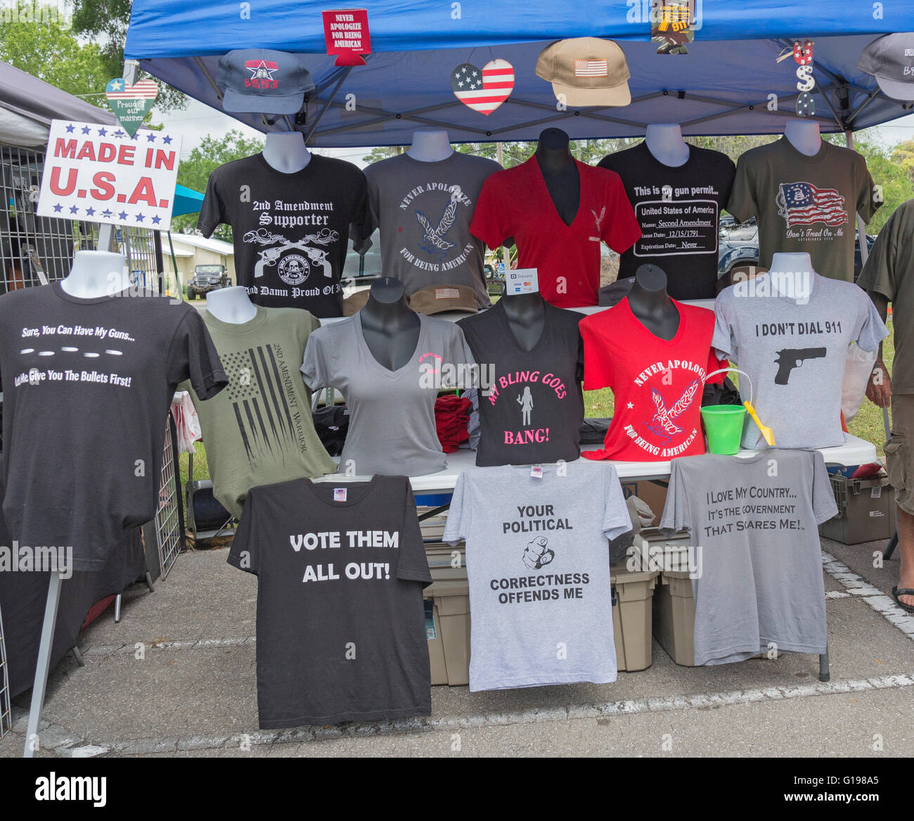Pioneer Days annual celebration in High Springs Florida. Vendor selling non-politically correct T-shirts. - Stock Image