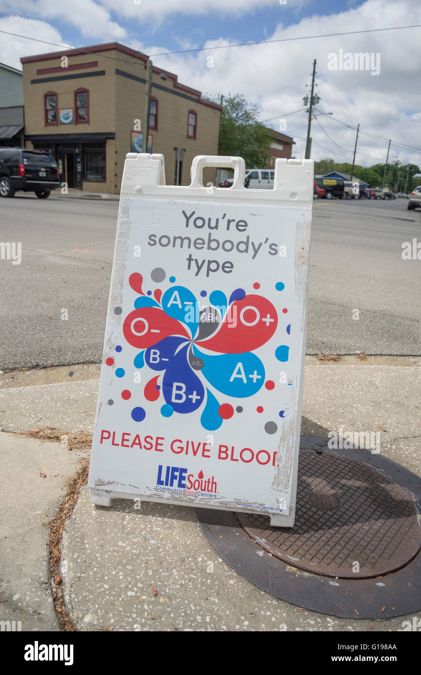 Blood donation sign at Pioneer Days Festival in High Springs, Florida. - Stock Image