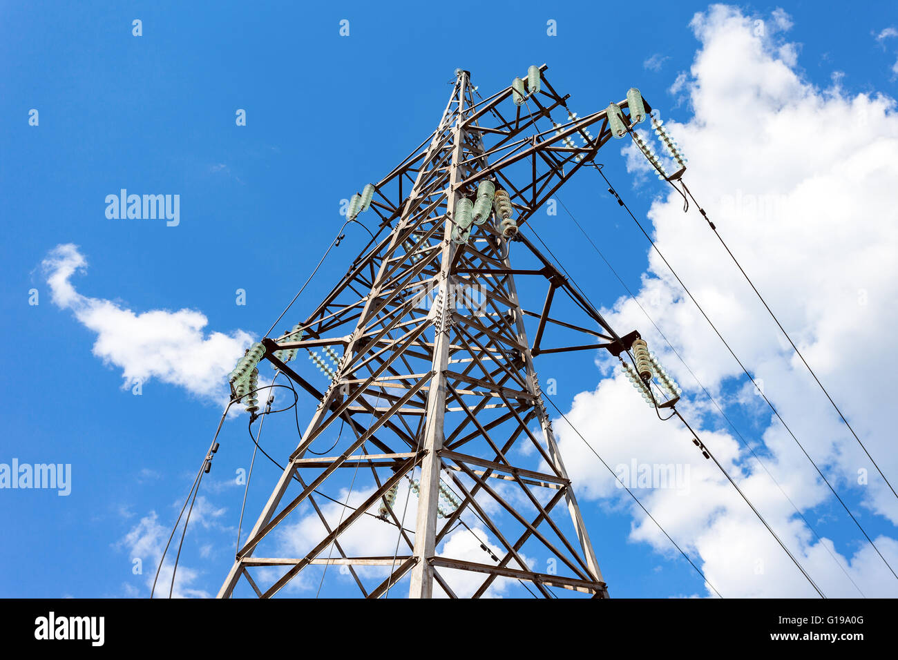 High voltage tower with ragged high-voltage line - Stock Image