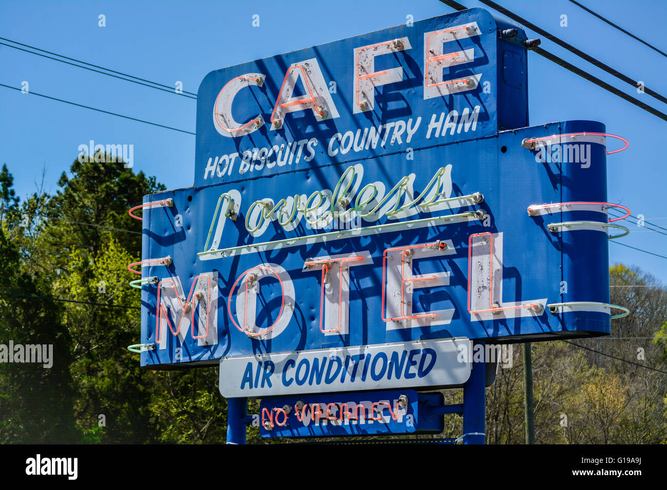 Big blue neon road Sign for the famous Loveless Motel and Cafe near Nashville, TN, famous for their Hot Biscuits - Stock Image