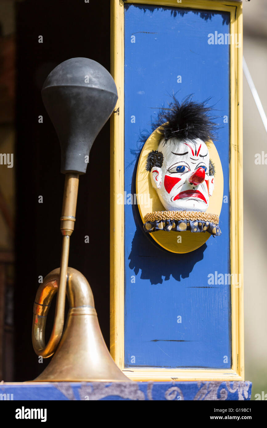 Signal horn and clown's face at the 41st Annual Covent Garden May Fayre and Puppet Festival takes place in the - Stock Image