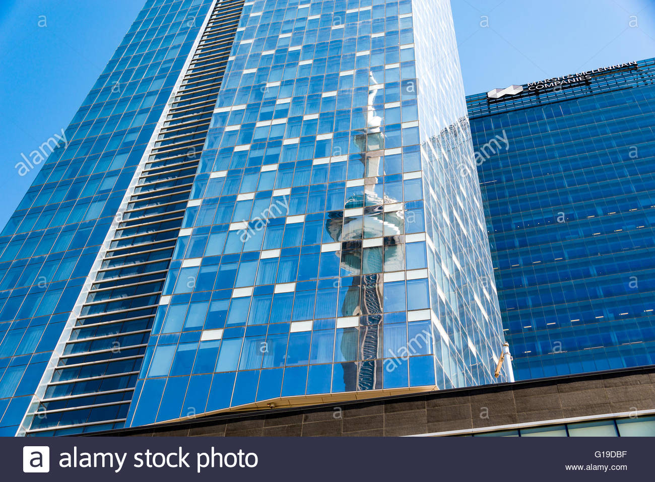 Reflection of CN Tower, on glass windows of tall skyscraper. The Tower is a symbol of Canadian history and a Landmark - Stock Image
