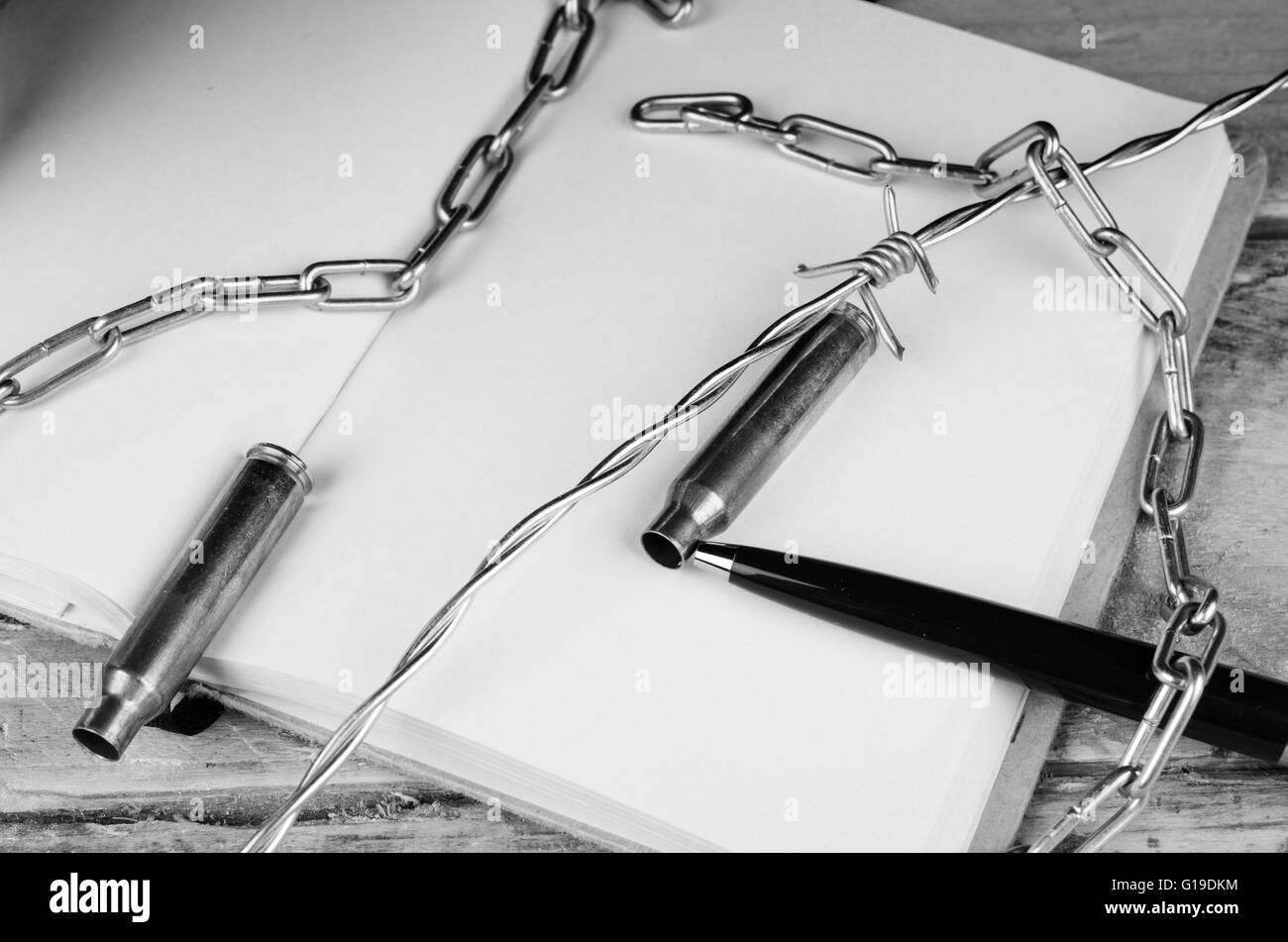 Bullets and barbed wire against pen and notebook, a press freedom ...