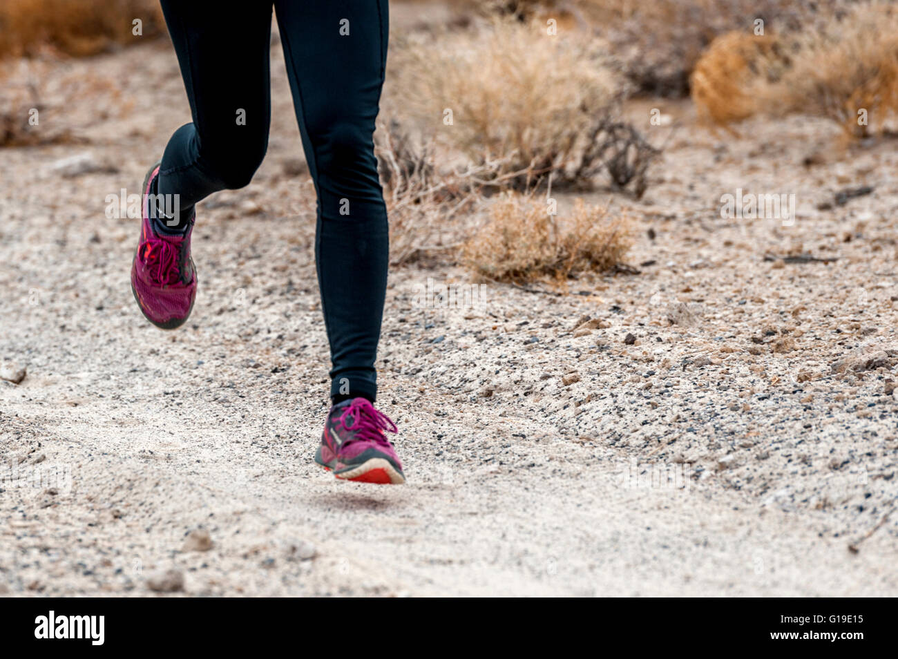 tight shot of legs and feet trail running - Stock Image