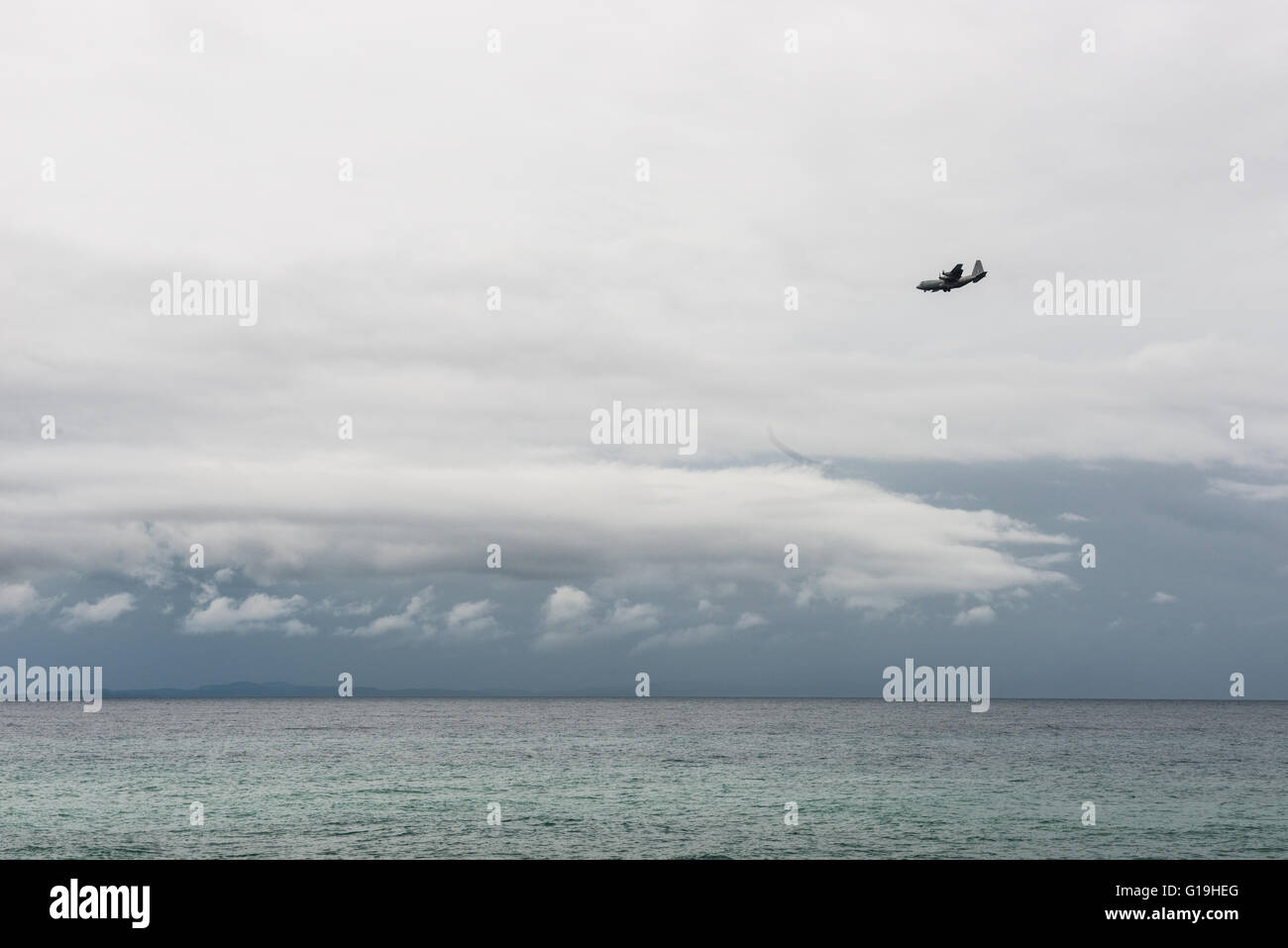 Military plane over Aegean sea at the Lesbos island coast near Mytilene on a stormy day Stock Photo