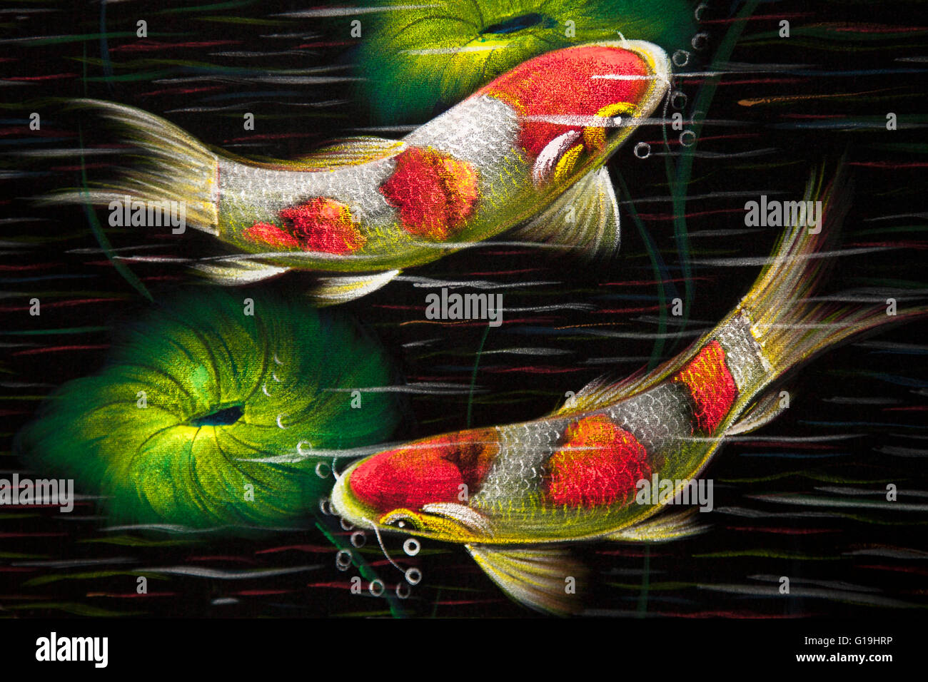 Street art of Thailand, with the sweeping curves of fish blowing bubbles. - Stock Image