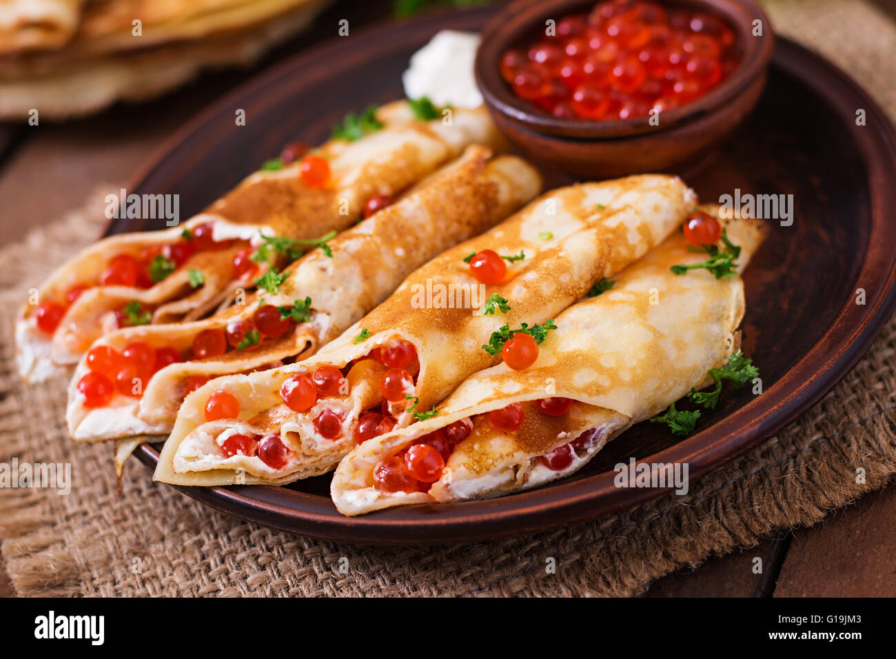 Pancakes with red caviar and cream cheese - Stock Image
