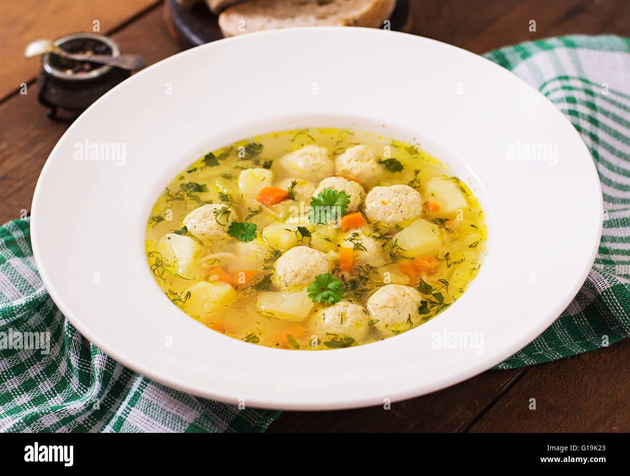 Dietary soup with chicken meatballs and stalks of celery - Stock Image