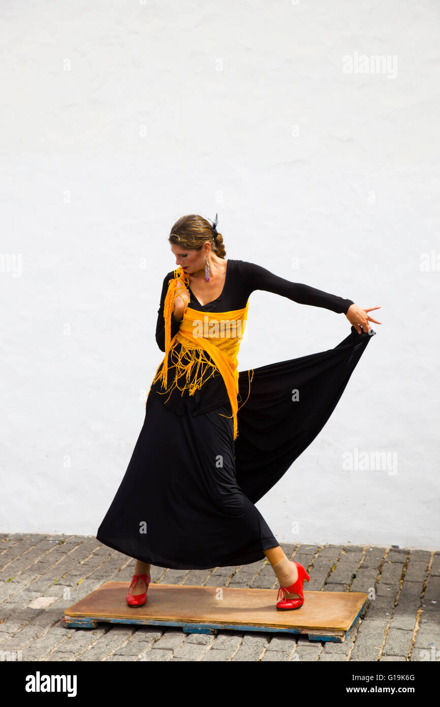 Flamenco dancer with a black dress and red shoes. Lanzarote 2014 - Stock Image