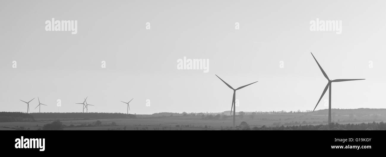 Wind turbine silhouettes in County Durham, North East England. - Stock Image