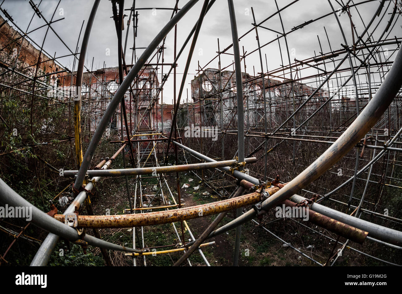 Lots of scaffolding supporting structure inside Abandoned building - Stock Image