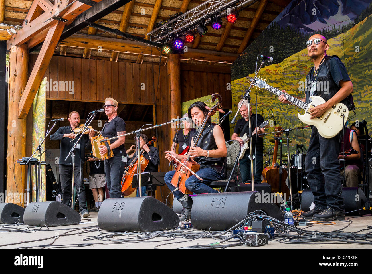 Oysterband jam with chinese group Hangai, Canmore Folk Music Festival, Canmore, Alberta, Canada - Stock Image