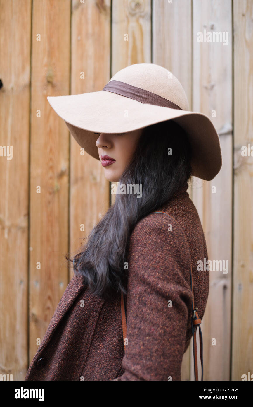 031b6a472b3 Portrait of a woman with hat covering her face Stock Photo ...