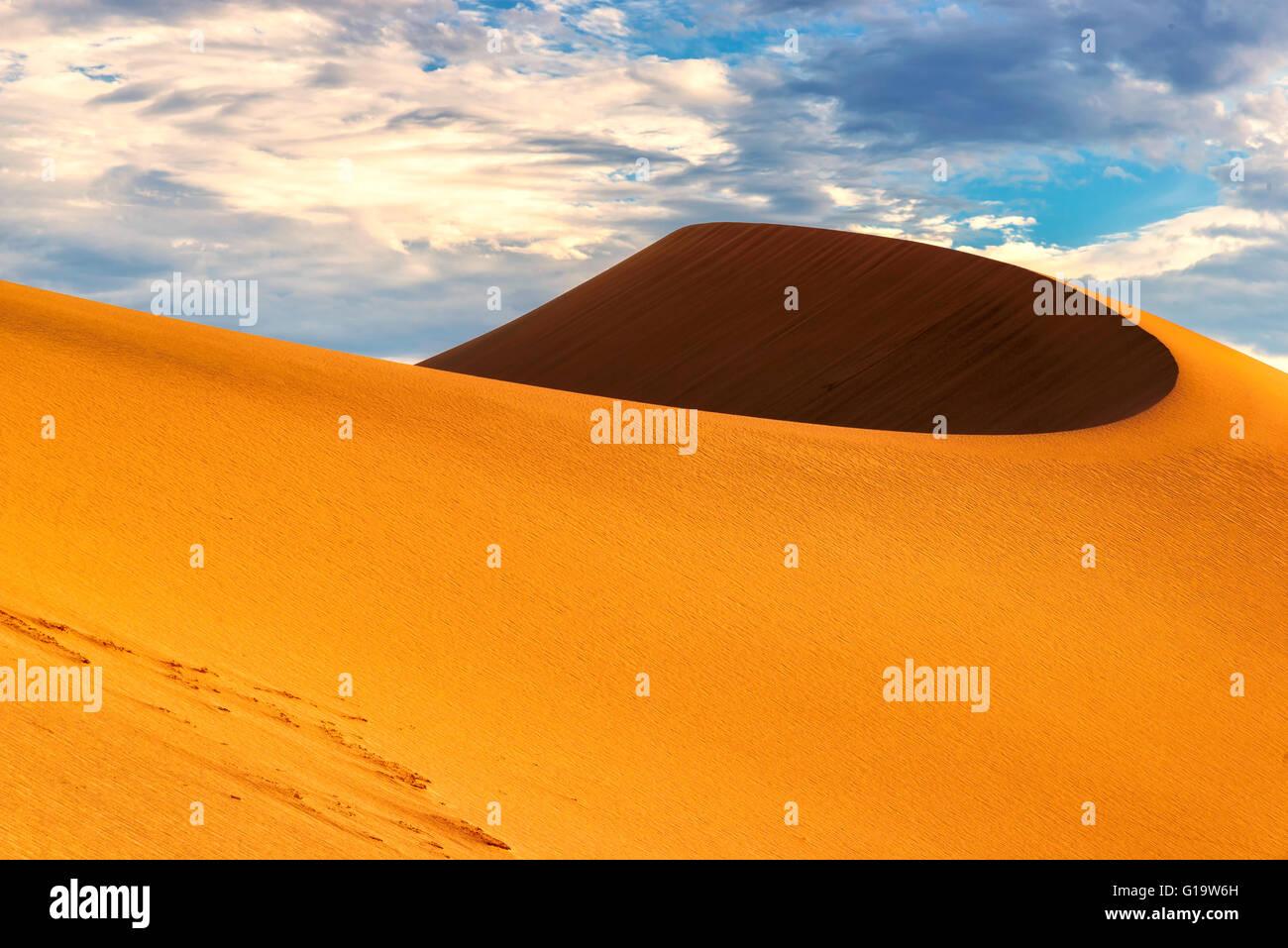 Sand dune at sunrise - Stock Image