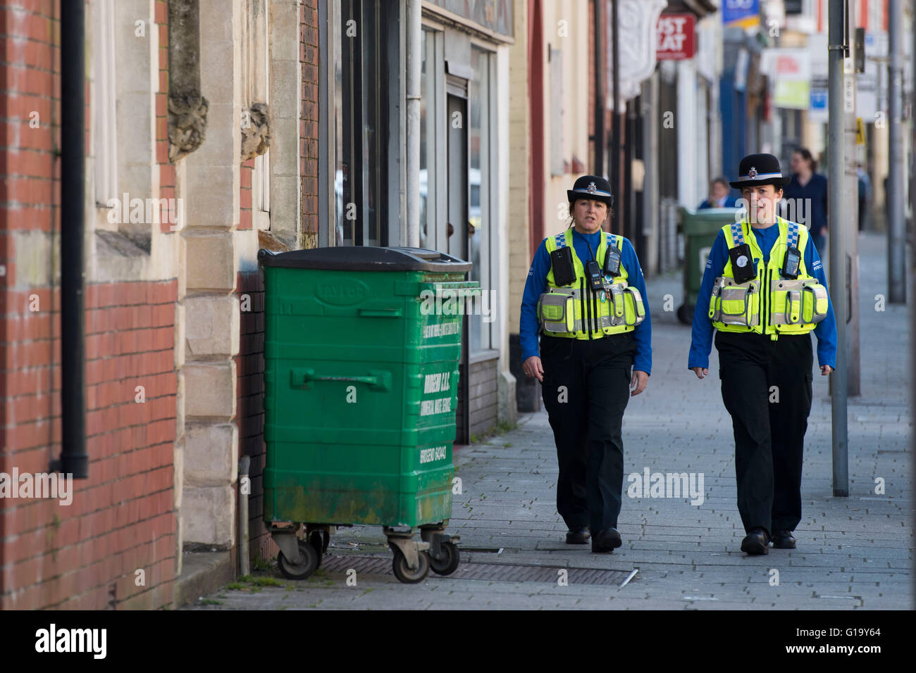 Female police officers on patrol in Maesteg, south Wales. - Stock Image
