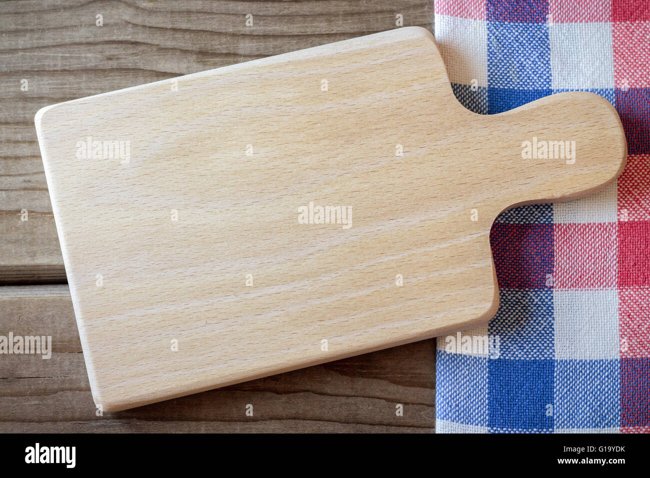 Empty cutting board on wooden table and kitchen rag. Concept for ...