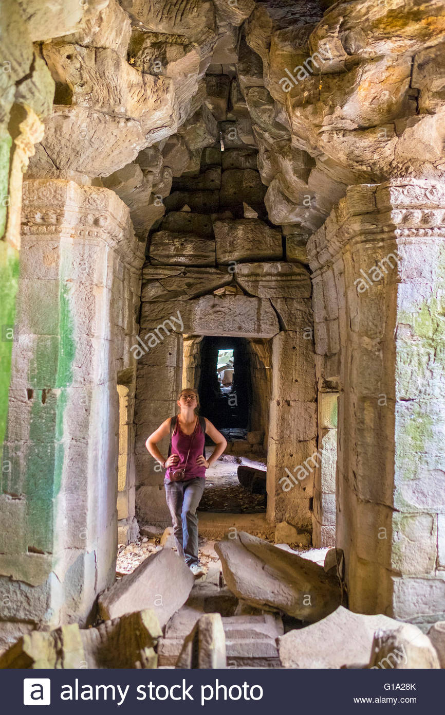 Tourist exploring Banteay Chhmar, Ankorian-era temple ruins, Banteay Meanchey Province, Cambodia - Stock Image
