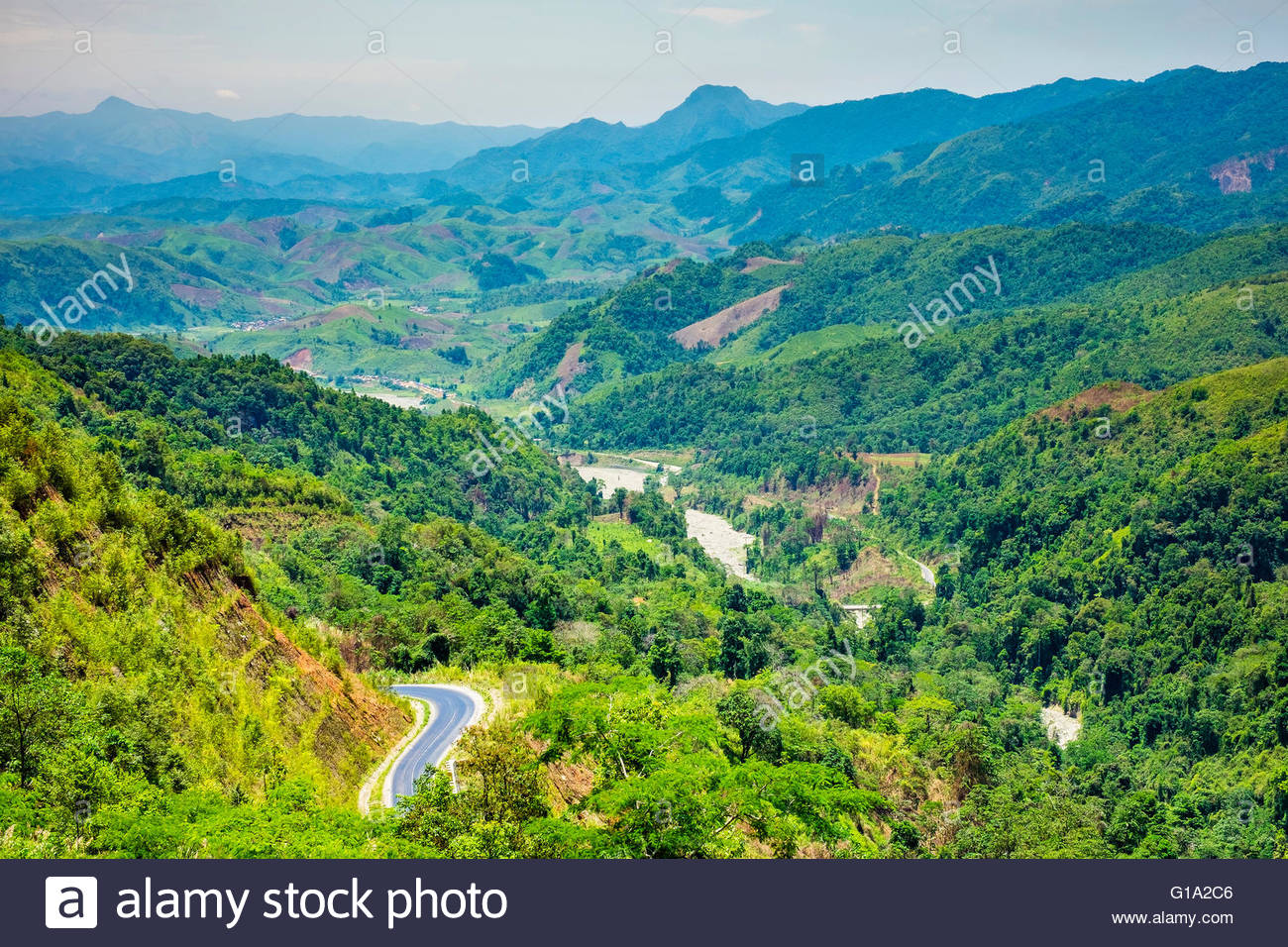 Rolling hills and mountains, lush rural landscape, Louangphabang Province, Laos - Stock Image