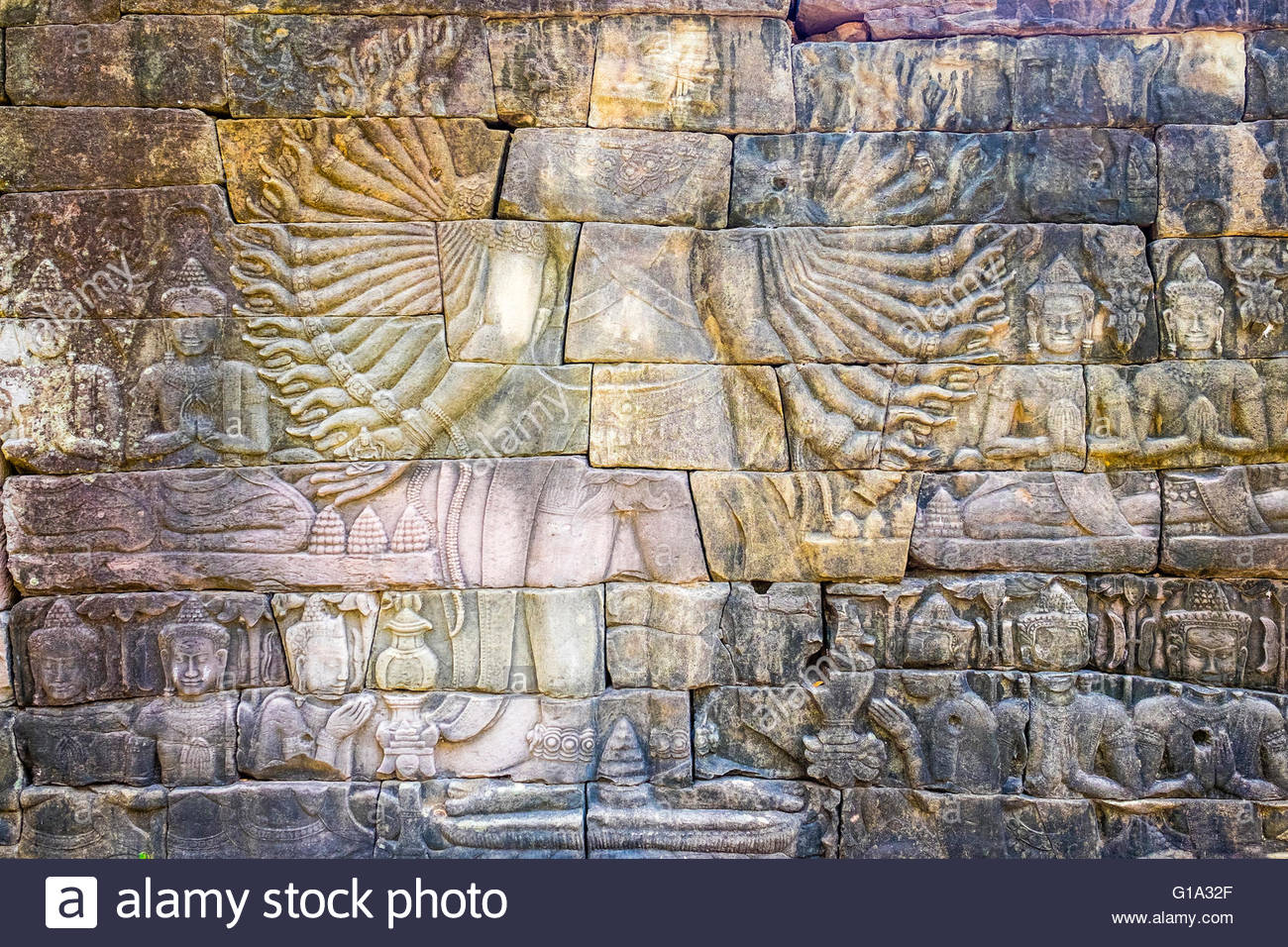Bas-relief stone carving depicting Lokeshvara with 32 arms on the southwestern enclosure wall at Banteay Chhmar, - Stock Image