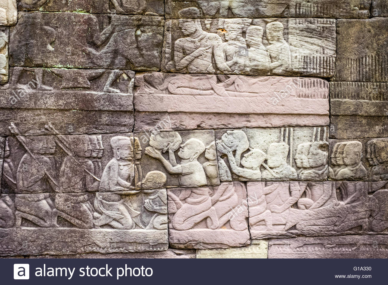 Bas-relief stone carvings depicting beheaded enemies, battle against the Cham, southern wall, Banteay Chhmar, Cambodia - Stock Image