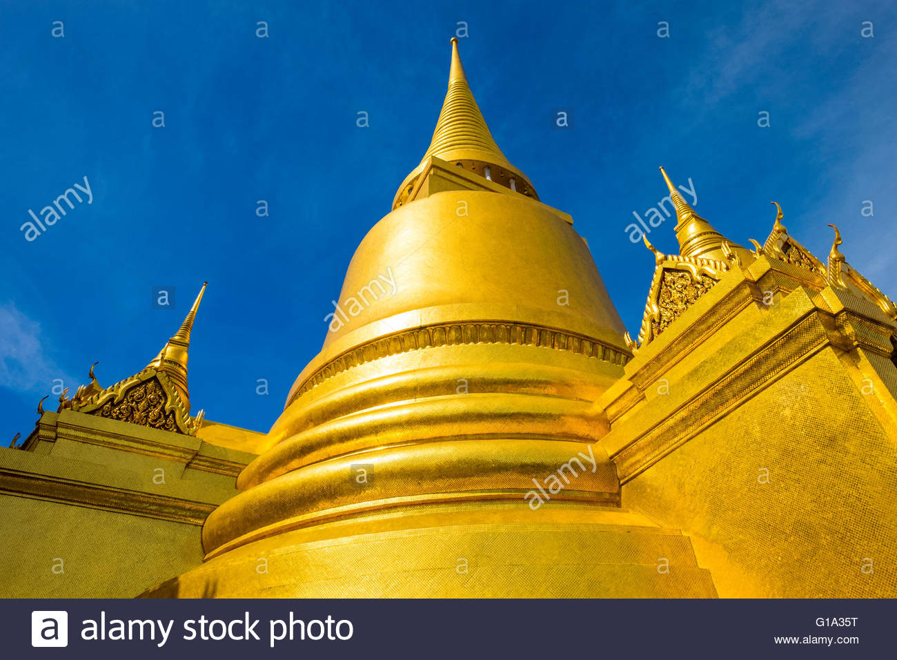 Phra Si Rattana Chedi golden chedi at Temple of the Emerald Buddha (Wat Phra Kaew), Grand Palace complex, Bangkok, - Stock Image