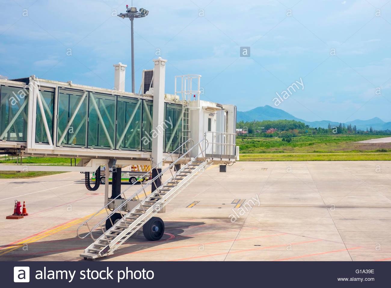 Gangway and tarmac at Luang Prabang Airport, Louangphabang Province, Laos - Stock Image