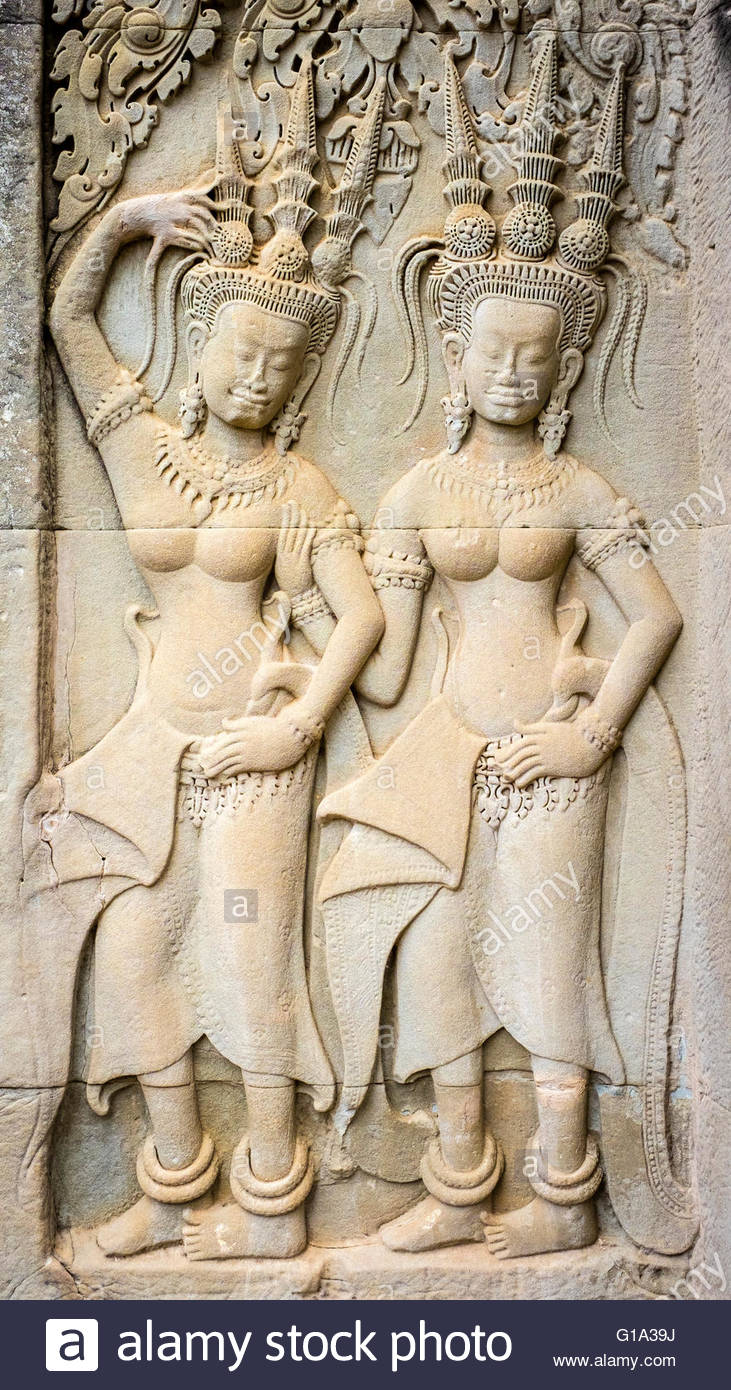 Stone carvings depicting female Devatas at Angkor Wat, UNESCO World Heritage Site, Siem Reap Province, Cambodia - Stock Image