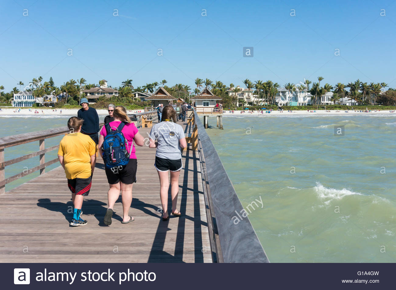 A windy day makes for rough seas along the city pier in Naples, Florida - Stock Image
