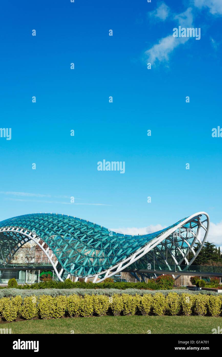 Eurasia, Caucasus region, Georgia, Tbilisi, Bridge of Peace on Mtkvari river Stock Photo