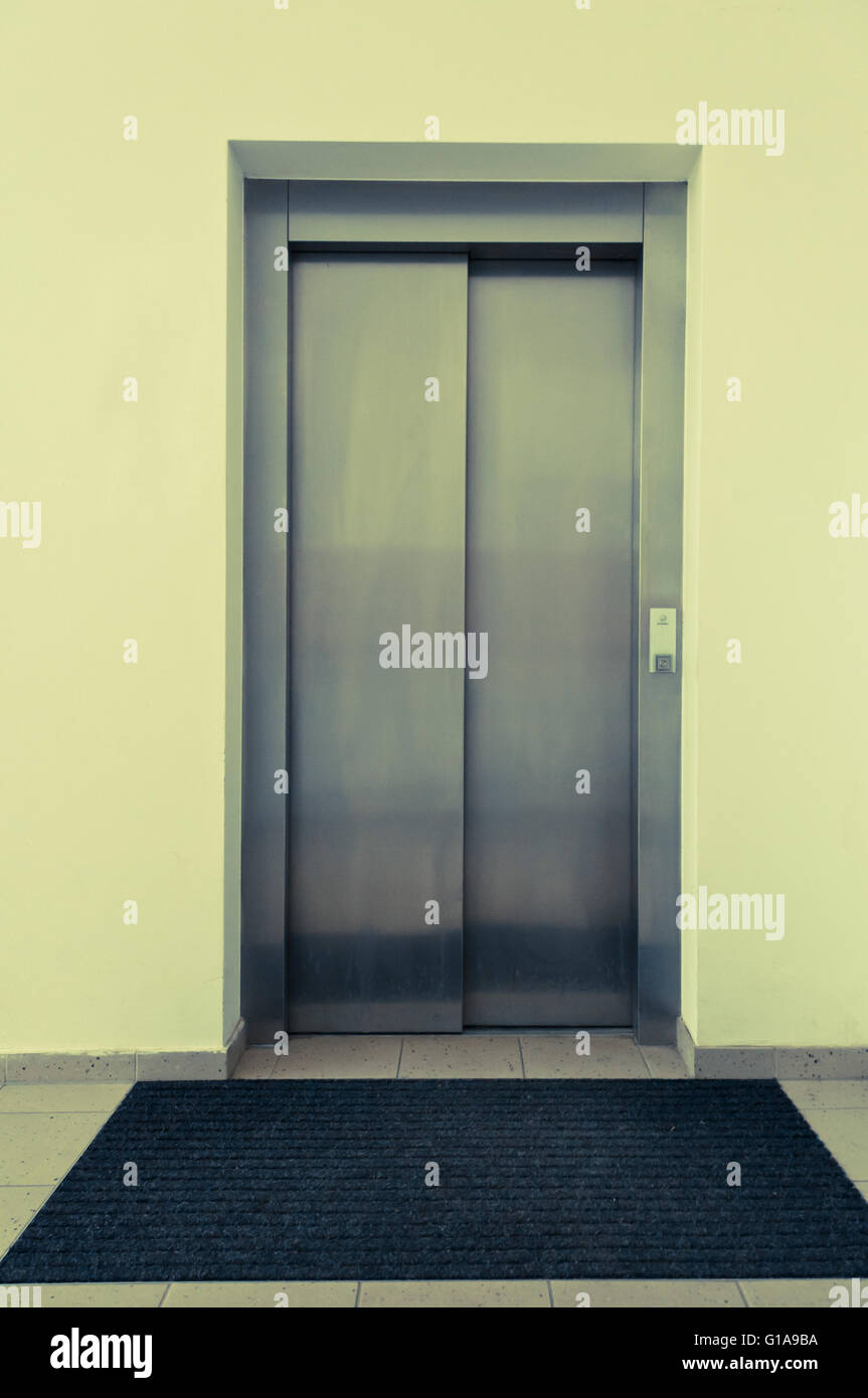 lift with closed doors - Stock Image